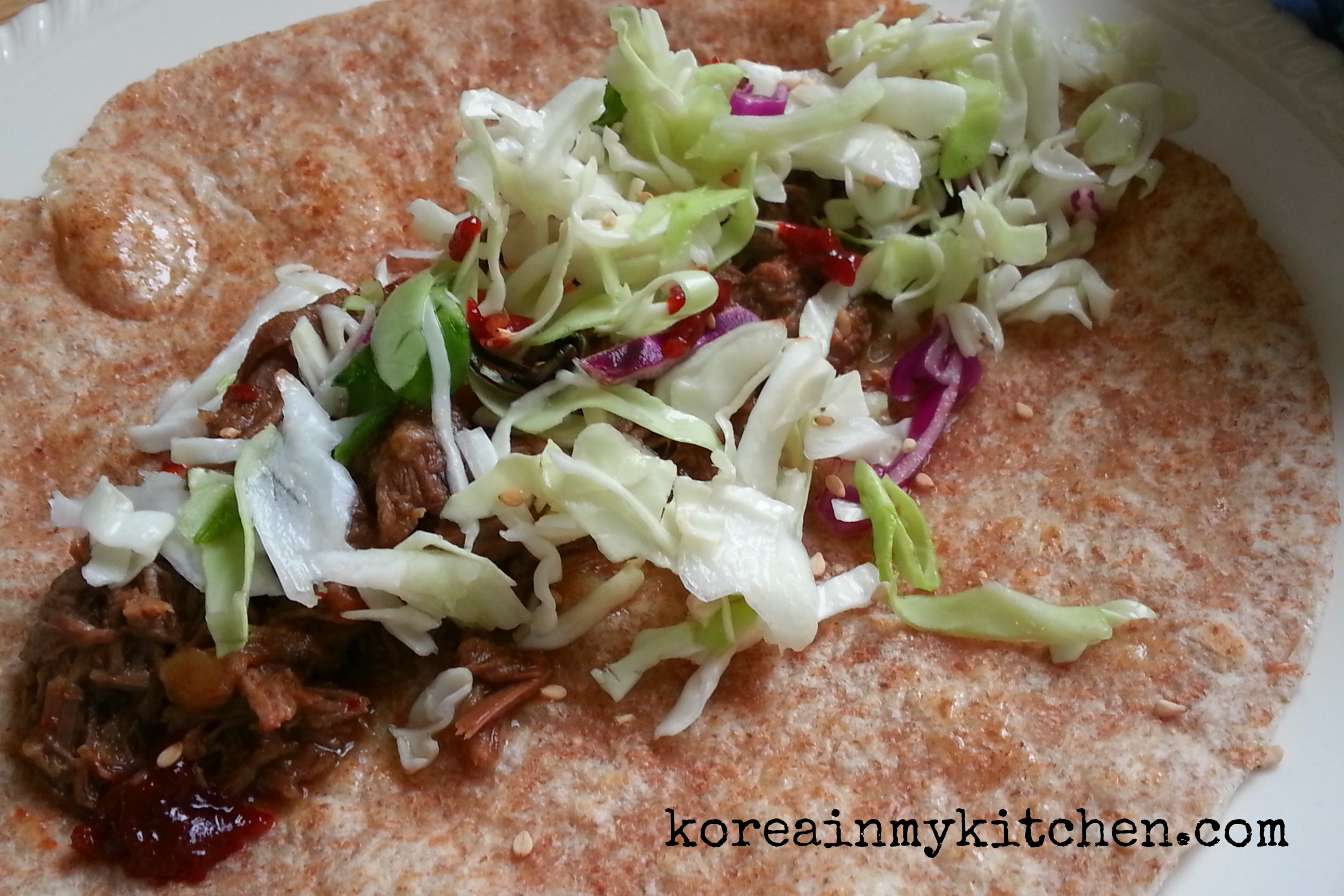 Shredded Korean beef tacos with cabbage slaw